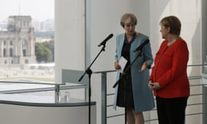 Angela Merkel, the German chancellor (right) and Theresa May addressing the media at the chancellery in Berlin.