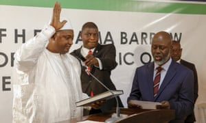 Adama Barrow, left, is sworn in as president of the Gambia.