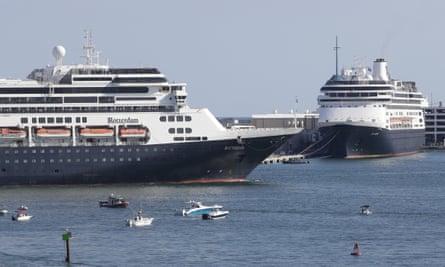 The Rotterdam, left, passes the Zaandam at Port Everglades in Florida.