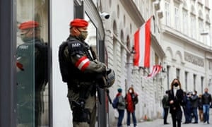 An armed member of the special forces stands guard near the site of the gun attack in Vienna
