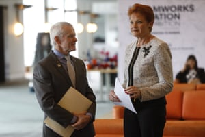 Pauline Hanson and Malcolm Roberts watch Immigration minister David Coleman at a press conference in the mural hall of Parliament House in Canberra this afternoon.