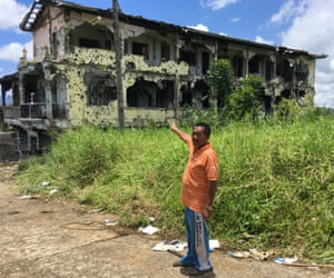 Abdul Tawab Amer in front of his property in the village of Moncado Colony in Marawi.