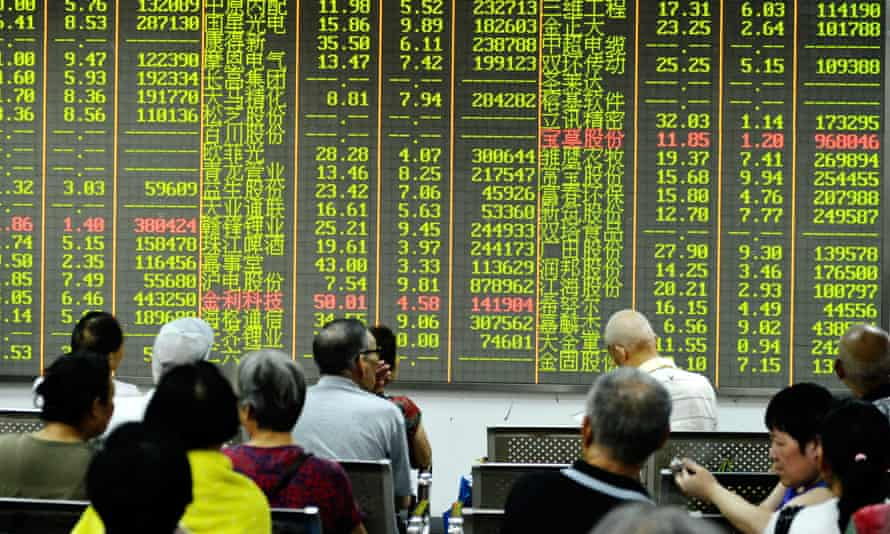 Chinese investors at a brokerage house in east China's Zhejiang province