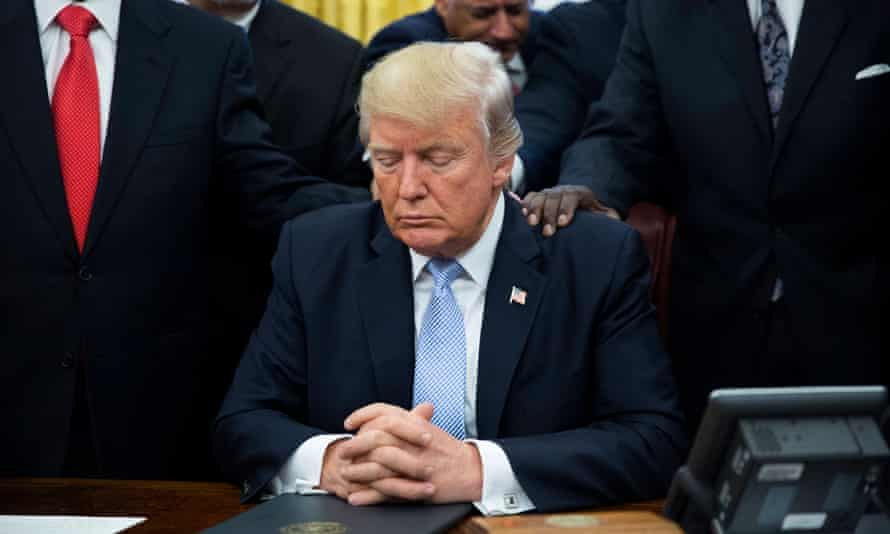 Donald Trump prays with faith leaders at the White House, after signing a proclamation for a day of prayer for victims of Hurricane Harvey.