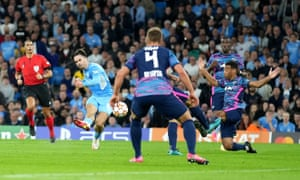 Jack Grealish of Manchester City scores his side's fourth goal.