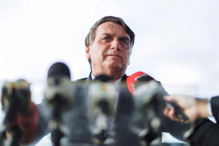 Jair Bolsonaro speaks to the media in Braília, Brazil, on 10 March.