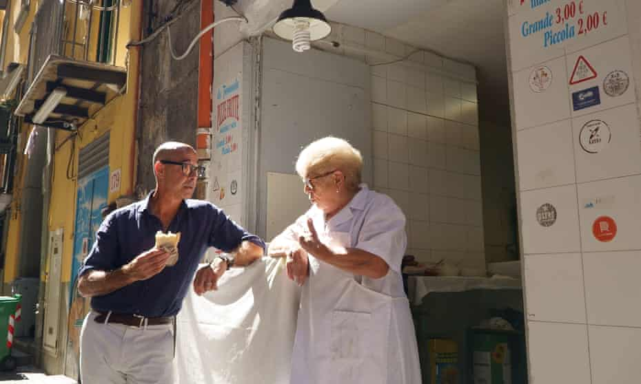 Stanley Tucci at a pizzeria in Naples