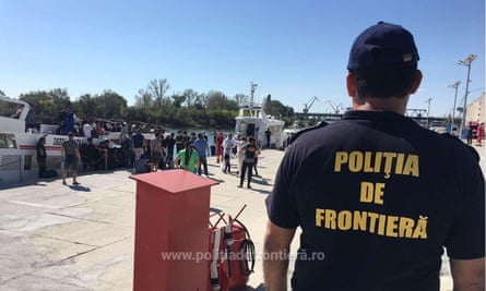 Border police in Romania with migrants who have crossed the Black Sea, on 9 September
