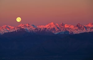 Full Moon over the Alps. The majestic sight of the full moon setting behind the rose-tinted Alps. Taken in the silent surroundings of Superga hill in Turin, Italy, mere minutes before sunrise