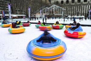 New York, US People ride bumper cars on the ice during the cold weather at Bryant Park