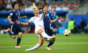 England's Rachel Daly gets a shot away despite pressure from Aya Sameshima of Japan.