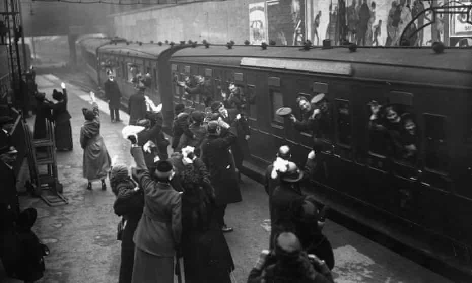 British soldiers on their way to the western front are waved off from Victoria station, London.