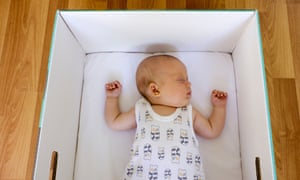 Infant sleeping in a Finnish baby box
