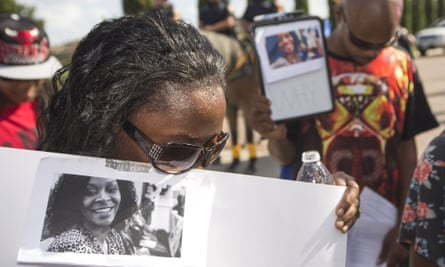 Margaret Hilaire bows her head in prayer during a demonstration in Katy, Texas, in 2015, after Sandra Bland's death.