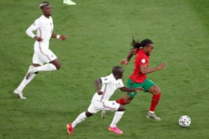Portugal's Renato Sanches (right) is chased by France's N'Golo Kante.