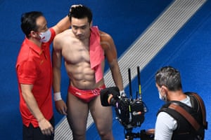 China's Cao Yuan is congratulated after winning to take gold in the men's 10m platform diving final.