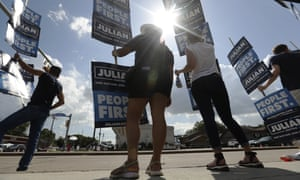 Supporters of Julián Castro gather near the site of the Democratic presidential primary debates on 12 September 2019 in Houston, Texas.