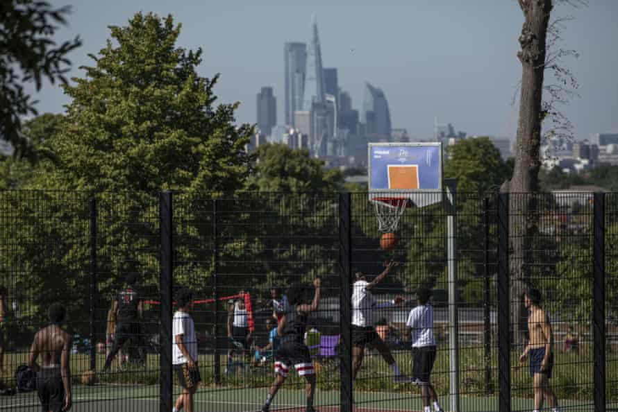 People play basketball in Brockwell Park, south London, on Wednesday.