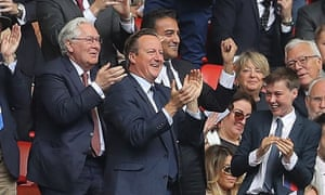 David Cameron celebrates Aston Villa's opening goal in the championship playoff with his son.