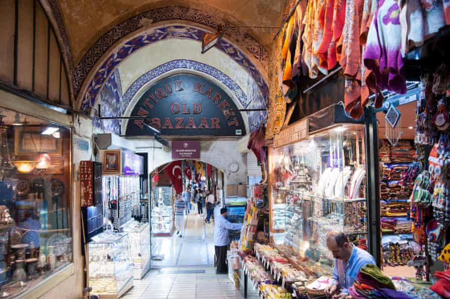 Interior of a shopping lane in the Grand Bazaar in Istanbul. Stalls are selling ceramics, silk scarves and jewellery.