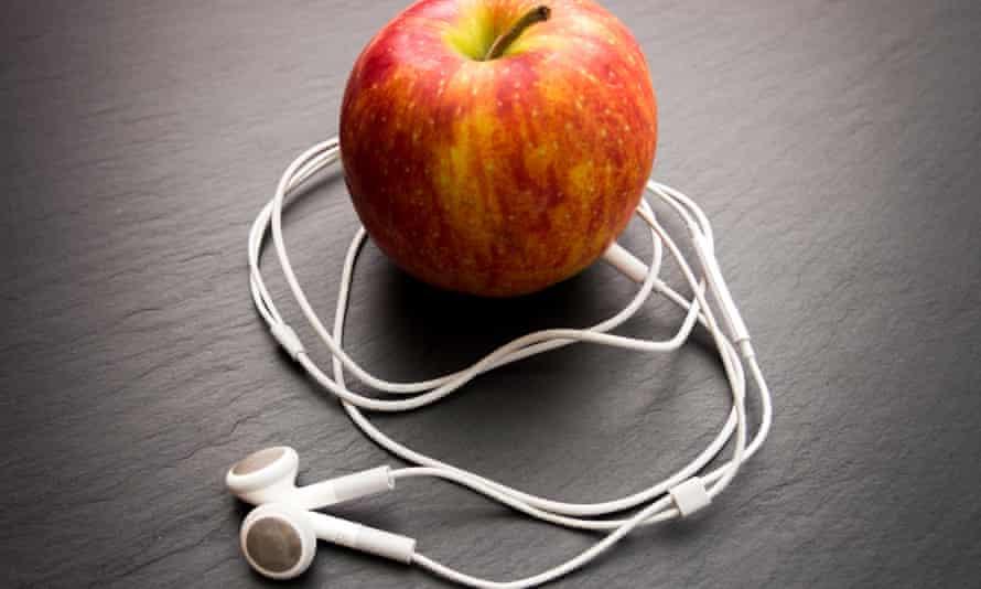 An apple with iPod earphones