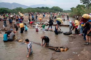 Cucuta, ColombiaPeople cross from Cúcuta in Colombia back to San Antonio del Táchira in Venezuela after buying goods to resell. Venezuela is in the grip of a humanitarian crisis due to shortages of food and medicine exacerbated by hyperinflation.