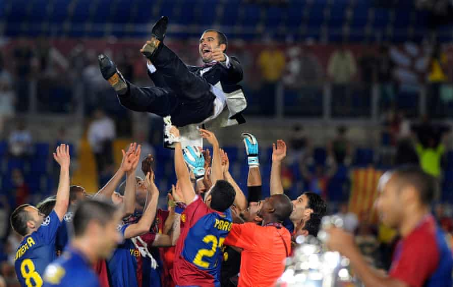 Pep Guardiola is thrown by Barcelona's players as in the foreground Sylvinho and Henry look at the Champions League trophy in 2009.
