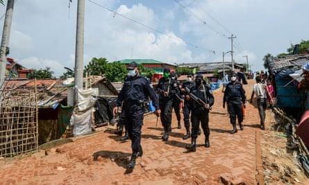 Bangladesh security forces patrol Jamtoli refugee camp near Cox's Bazar on 7 October 2020