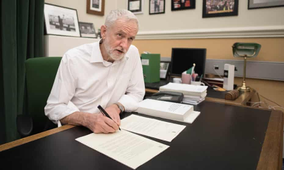 Jeremy Corbyn signs a letter he has written to Theresa May laying out Labour's five Brexit demands.