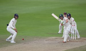 Australia's Alyssa Healy drives for four runs off the final ball of the morning session.