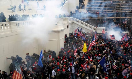 FILE PHOTO: Supporters of U.S. President Donald Trump gather in Washington<br>FILE PHOTO: Police release tear gas into a crowd of pro-Trump protesters during clashes at a rally to contest the certification of the 2020 U.S. presidential election results by the U.S. Congress, at the U.S. Capitol Building in Washington, U.S, January 6, 2021. REUTERS/Shannon Stapleton/File Photo
