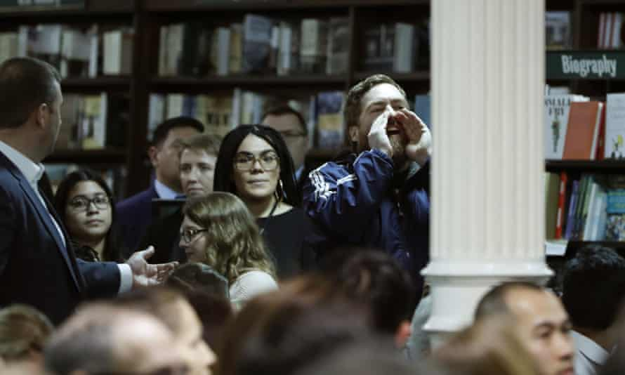A heckler shouts from the bookstore on Monday night.