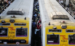Mumbai, India Commuters board a local train