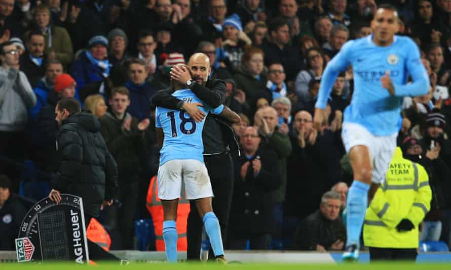 Pep Guardiola congratulates Fabian Delph during Manchester City's 4-0 win over Bournemouth last week.