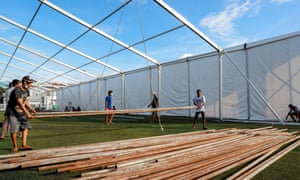Workers construct a field hospital on a football pitch in Yangon, Myanmar, on Tuesday.