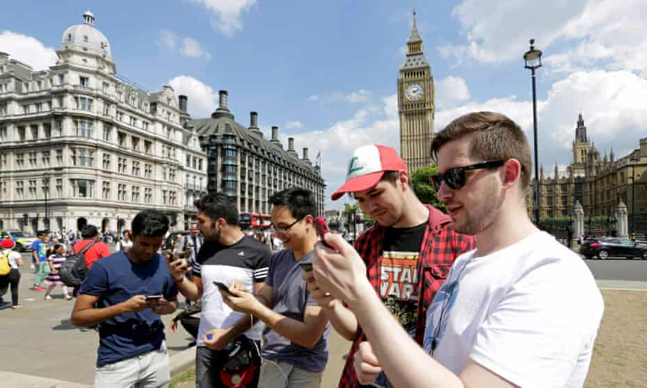 A group of men search for Pokémon Go characters in Westminster, London.
