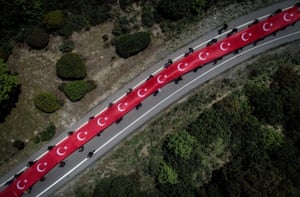 Çanakkale, Turkey. A drone photo shows a cortege carrying the Turkish flag to the 57th Regiment Cemetery during an event held for Turkish soldiers at the Gallipoli peninsula