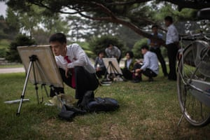 North Korean students take part in a painting workshop at a park in Pyongyang, North Korea