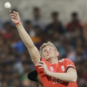 England's Joe Root reaches to make god his catch.