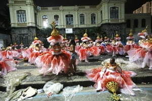 Members of the Portela samba school wait to perform outside the Sambodrome