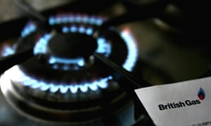 A blue-flamed gas cooker ring next to a British Gas bill