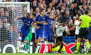 Chelsea players appeal for a penalty.