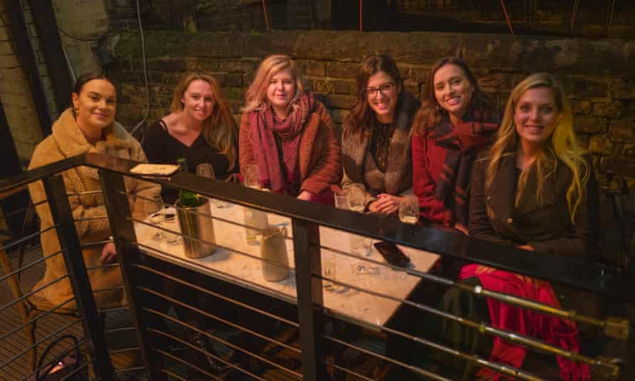 Alex Irving, second left, and Ellie Camm, far right, out with their co-workers in Shoreditch, London, on the eve of stricter restrictions