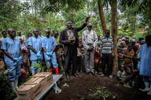 Mourners attend the burial of an 11-month-old girl who died in the town of Rutshuru, North Kivu province, during the Ebola outbreak in February 2020