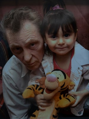 Tasnim, aged three, with her grandfather, George, who cared for her after her mother was killed.