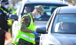 ADF personnel works at vehicle checkpoint on Princes Freeway outside Melbourne