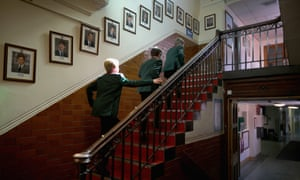 Boys at grammar school climbing stairs