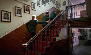 Pupils make their way to class past photographs of former headboys at Altrincham Grammar School for Boys
