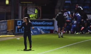 Gareth Ainsworth and his Wycombe team celebrate victory in their play-off semi-final against Fleetwood.