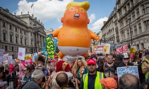 Trump baby balloon and protesters in London